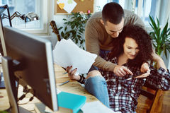 Couple working at home Stock Photos