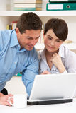 Couple Working From Home Using Laptop Royalty Free Stock Images