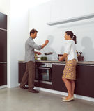 Couple working in kitchen Stock Image