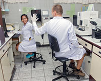Couple working in the laboratory Stock Photography