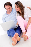 Couple working on a laptop Stock Image