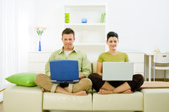 Couple working on laptop Stock Photography