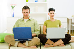 Couple working on laptop Royalty Free Stock Images