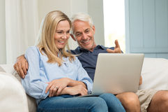 Couple working on laptop Royalty Free Stock Photography