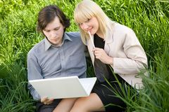 A couple working on laptop in nature Royalty Free Stock Photo