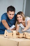 Couple Working On Model House Stock Images