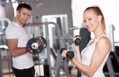 Couple working out with dumbbells Stock Photography