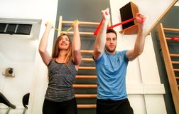 Couple working out exercise with stretch exercise rubber bands f Royalty Free Stock Images