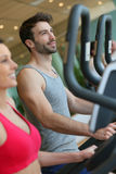 Couple working out in a fitness center Stock Photography