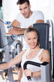 Couple working out at a health club Royalty Free Stock Image