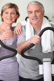 Couple working out at home stock photography