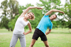 Couple working out in park Stock Photo