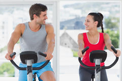 Couple working out at spinning class in bright gym Royalty Free Stock Photo