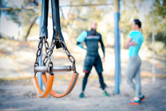 Couple working out with sport equipment on foreground Royalty Free Stock Photo