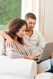 Couple working on their laptop Royalty Free Stock Photos