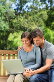 Couple working on their laptop Royalty Free Stock Images