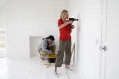 Couple Working On Their New Home Royalty Free Stock Photography