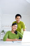 Couple working together stock images