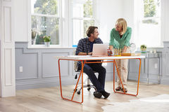 Couple Working Together At Desk In Home Office Royalty Free Stock Images