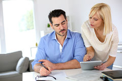 Couple working together at home Royalty Free Stock Images