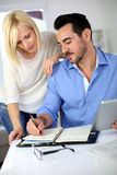 Couple working together from home Stock Photography
