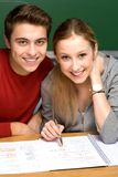 Couple working together on school work Royalty Free Stock Photos
