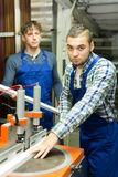 Couple of workmen at factory Royalty Free Stock Photo