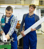 Couple of workmen at factory Stock Photos