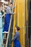 Couple of workmen inspecting  PVC Stock Photo