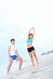Couple workout on beach Stock Photo