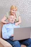 Couple works on the laptop Stock Photography