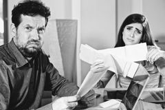 Couple worried about taxes black and white Stock Photos