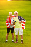 Couple wrapped in American flag. Royalty Free Stock Image