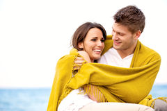 Couple Wrapped with Blanket Embracing Stock Image