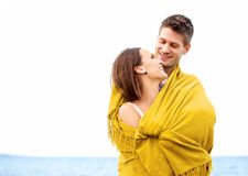 Couple Wrapped with Blanket Looking at Each Other Royalty Free Stock Photography