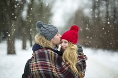 Couple wrapped in blanket outdoors Stock Images