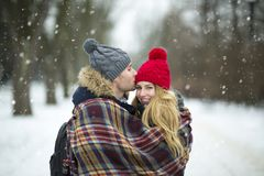 Couple wrapped in blanket outdoors Stock Photography
