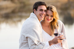 Couple wrapped in blanket wine Royalty Free Stock Image
