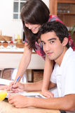 Couple writing on atable Stock Images