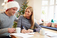 Couple Writing Christmas Cards Together Stock Photos