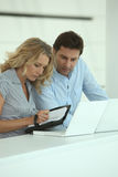 Couple writing in diary Royalty Free Stock Image