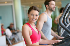 Couple wroking out in a fitness club Stock Photo