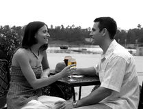 Couple XVII. Couple drinking wine. Lake in the background Royalty Free Stock Photography