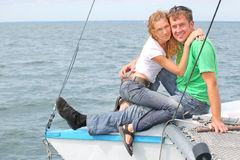 Couple on the yacht. Man and girl sits on the boad Royalty Free Stock Photography