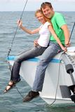 Couple on the yacht. Man and girl sits on the boad Stock Photo