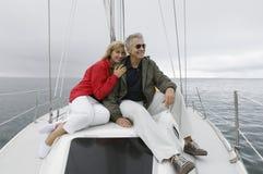 Couple On Yacht. Happy Caucasian couple on yacht Stock Photography