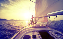 Couple on the yacht. Young couple looking to the sunset on the yacht in Andaman sea stock photography