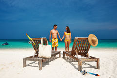 Couple in yellow on a beach at Maldives Stock Photo