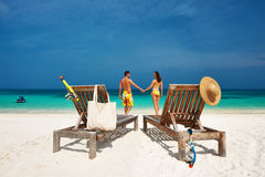 Couple in yellow on a beach at Maldives Royalty Free Stock Photos