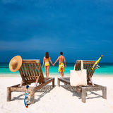 Couple in yellow on a beach at Maldives Royalty Free Stock Images